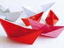 """multicolored paper origami boats"""